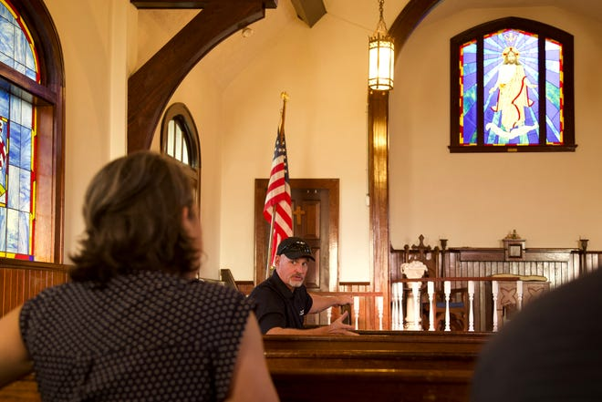 Stained-glass windows are featured on some walls of the Thomas Oakman chapel in Hope Mills.