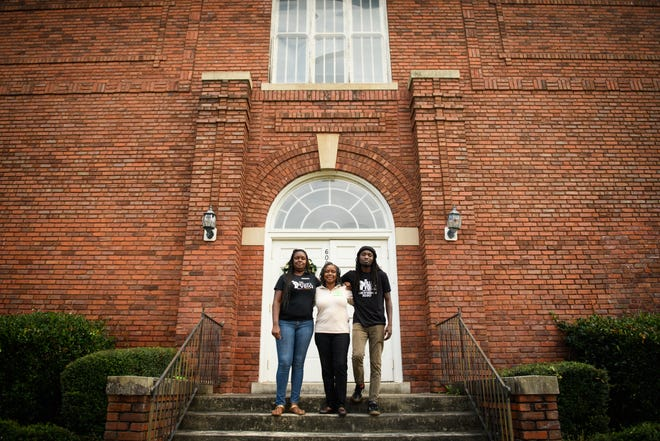 From left, Miranda Moore, Georgeanna Pinckney and Rakeem Jones stand in front of the former Orange Street School. Greater Life of Fayetteville and the Ville's Voice are operating a community center from the school.
