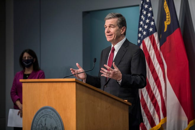 Gov. Roy Cooper speaks about the rise in COVID-19 cases in North Carolina during an Oct. 21 news conference in Raleigh. [AP FILE PHOTO]