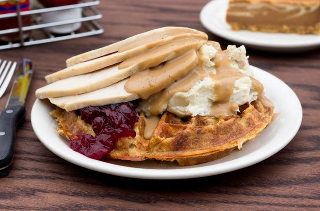 Metro Diner's savory Stuffing Waffle with Turkey consists of a waffle made from stuffing, topped with mashed potatoes, gravy, roasted turkey and a side of cranberry sauce. It's available at the restaurant through Nov. 29.