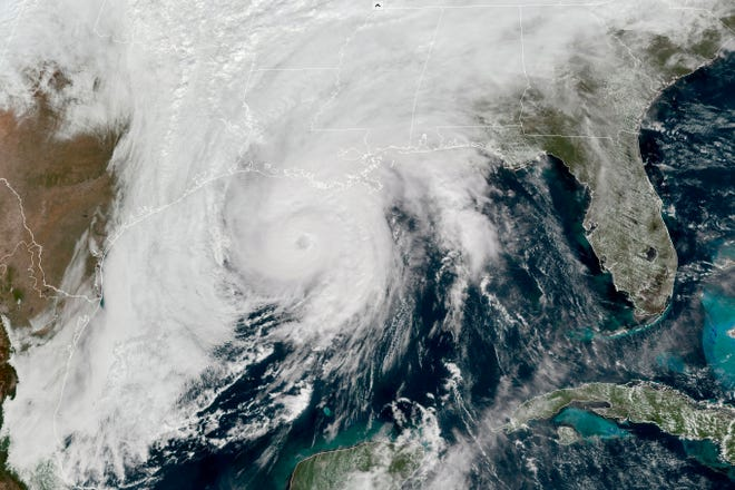 This GOES-16 GeoColor satellite image taken, Wednesday, Oct. 28, 2020, at 1 p.m. EDT, and provided by NOAA, shows Hurricane Zeta in the Gulf of Mexico nearing Louisiana.