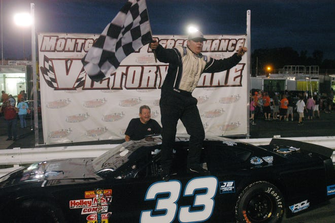 Dillon Harville celebrates in victory lane after winning a Limited Late Models race in May at Ace Speedway.