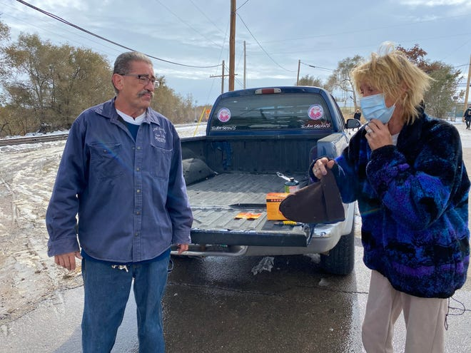 Pastor Paul Montoya, left, and 'Michele', a homeless woman who knew a man found dead Monday along Fountain Creek Monday share memories of the man near the site of his death.