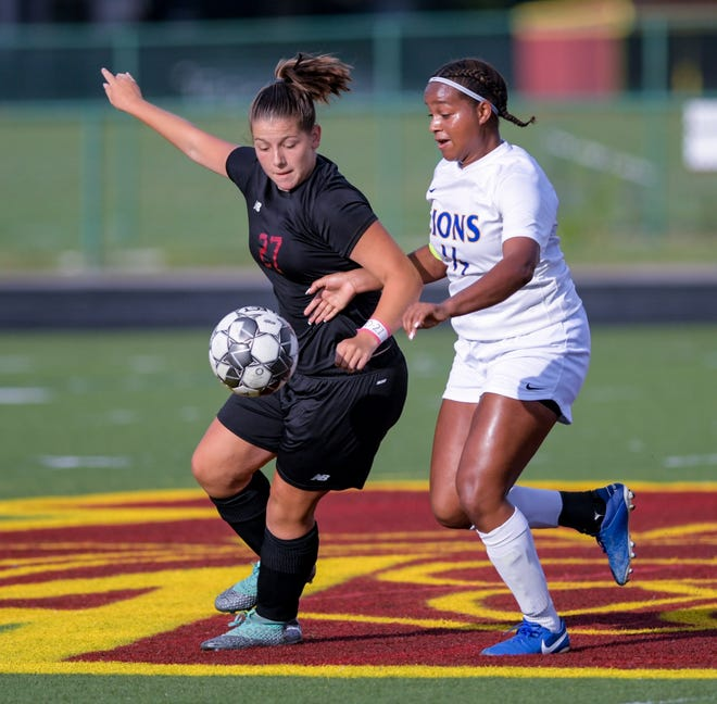Junior defender August Weise (left) and the North girls soccer team saw their season end Oct. 24 with a 2-1 loss to Big Walnut in the second round of the Division I district tournament. The Warriors finished 10-7-1.