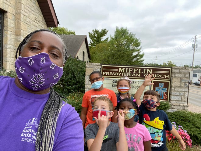 Students in the YWCA Kids Place at Mifflin Presbyterian Church include (back row, from left) Drew Tolliver, Mila Weitz, (front row) Alton Hartley, Nina Tolliver and Aloysius Herrick. In front of them is Kristy Hylton, site director of Jefferson Kids Place.