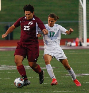 Will Root (left) is one of six seniors for the Canal Winchester boys soccer team, which finished 6-7-5 overall and 1-4-2 in the OCC-Cardinal Division.