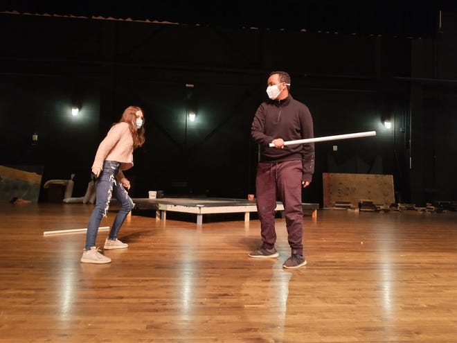 "New Albany High School senior Meghan Hohman, 17, who plays Agnes, rehearses a combat scene Oct. 27 with junior Mahdi Ahmed, 16, who plays Miles, in the school's production of ""She Kills Monsters: Young Adventurers Edition."" The play will be performed for both in-person and online audiences several times this month."