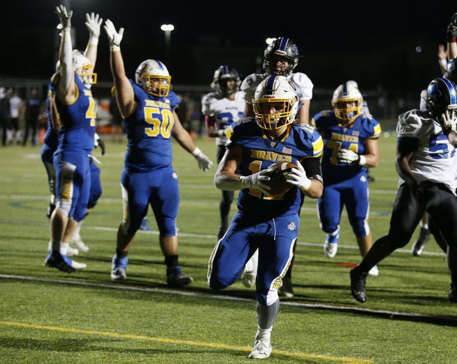 Olentangy's Landon Johnson scores a touchdown against Worthington Kilbourne on Oct. 23. The Braves won the Division II, Region 7 playoff game 35-13.
