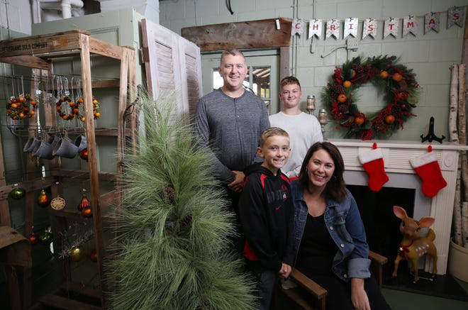 Dan and Kiki Caines bought Fisher's Gardens, 1540 Truro Ave., from Bee Fisher Kocher and her husband, Brian. The Caines, shown with sons Tristian (front left) and Troy, plan to open Nov. 14 with a Christmas gift shop.