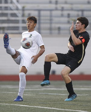 Junior midfielder Soshi Tanaka, left, is among the top expected returnees for the Coffman boys soccer team, which finished 7-5-4 in Terry Smith's first season as coach.