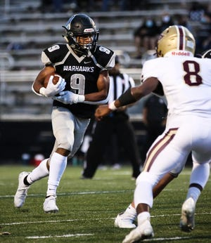Westerville Central's Michael Ross carries the ball in a 50-7 win over New Albany on Oct. 23.