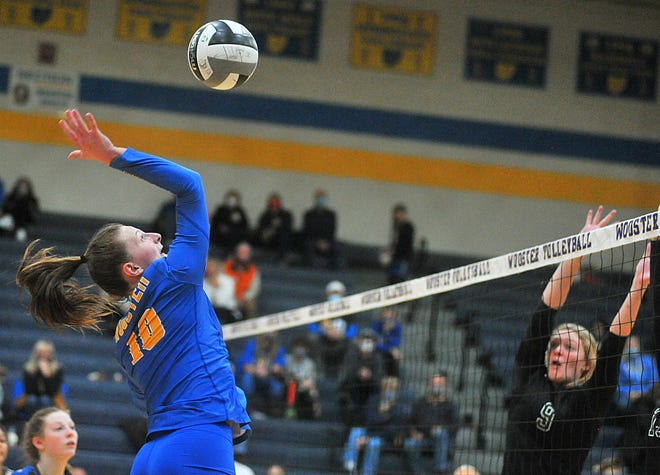 Wooster's Emmaleigh Allen (10) goes for the kill.