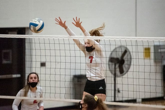 Marshall senior Olivia Webber (7) blocks the ball from St. Mary Catholic Central on Tuesday, Oct. 27, 2020 at Marshall High School.