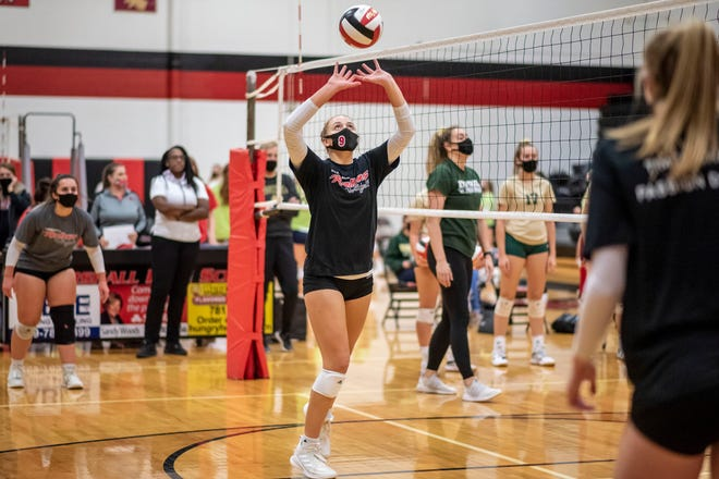 Marshall senior Abby Welke sets the ball while warming up before a match against St. Mary Catholic Central on Tuesday, Oct. 27, 2020 at Marshall High School.