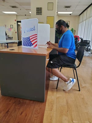 Antonne Henshaw, a Camden man who spent 30 years in prison, votes for the first time in the June primary election.