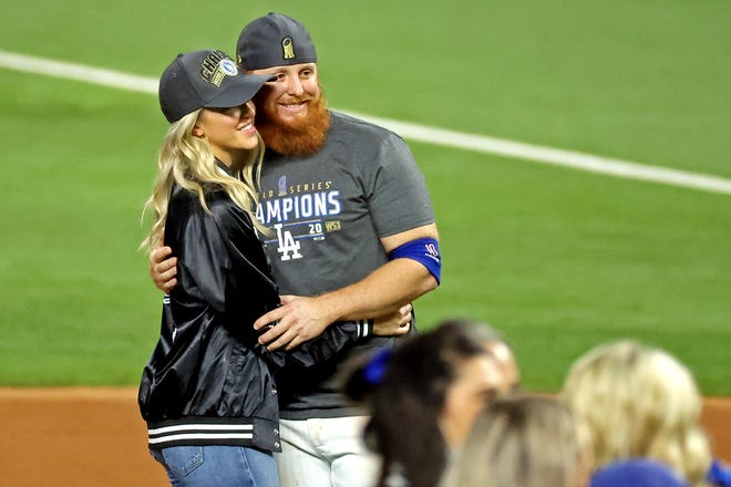 Los Angeles Dodgers third baseman Justin Turner (10) poses for a picture with his wife Kourtney Pogue after the Los Angeles Dodgers beat the Tampa Bay Rays to win the World Series in Game 6 of the 2020 World Series at Globe Life Field on Oct. 27.