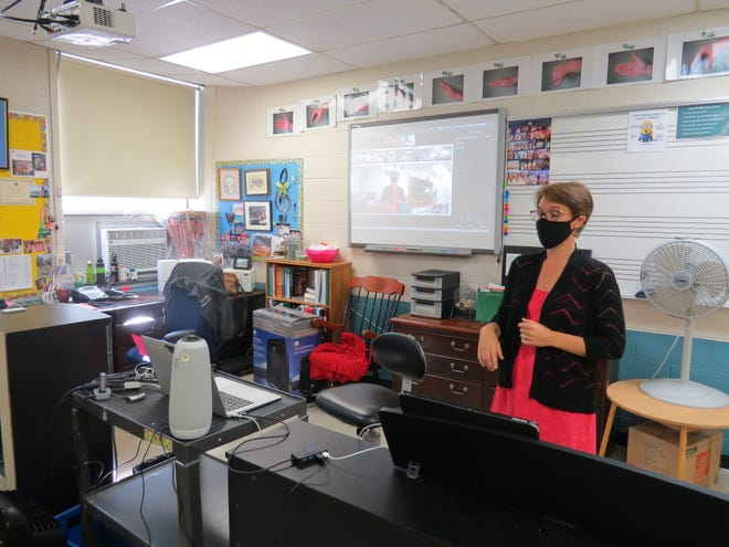 Performing Arts Department Chair Sharon Byrne of South Plainfield uses the Owl camera system to connect with students in various locations while teaching a music class.