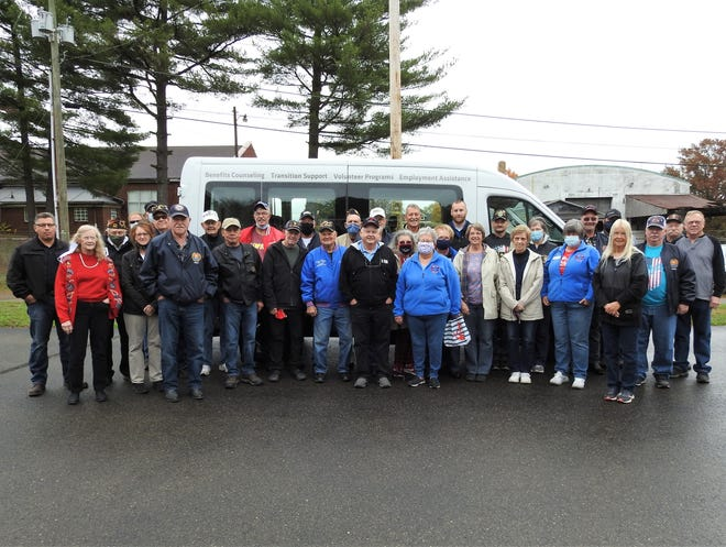 Various individuals and members of local veterans organization gather on Wednesday to review a new van. Local donations and fundraising totaling $23,000 assisted with the purchase of the $45,000 vehicle.