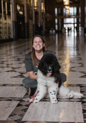 Liz Blondy and her dog, Clover. Blondy owns Canine to Five, which has two locations in metro Detroit. She stayed open during the pandemic and helped care for front-line workers' dogs.