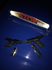 Michigan State Police said these two weapons were confiscated from a man and woman during a traffic stop Wednesday in Roseville. Both were intoxicated, they said.