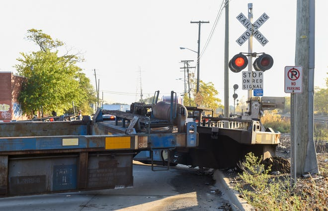 A train is derailed on Southern Street in Dearborn, Wednesday, October 28, 2020.