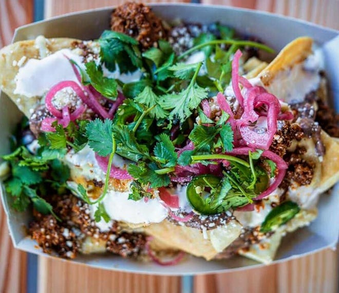 Death by Taco also offers nachos loaded with chorizo, refried black beans, queso, pickled onions, jalapeno, crema, cotija cheese and cilantro.