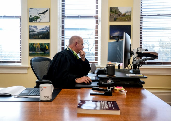 District Judge John Kutzman conducts online hearings from his chambers in the Cascade County Courthouse on Tuesday, October 27, 2020. His courtroom is currently being used as the jury room in an active trial because the regular room is not large enough to allow jurors to socially distance.