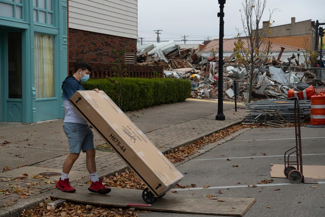 Jason Stone wheels a delivery into Alles Brothers Furniture Company in the 200 block of First Street in Downtown Henderson Wednesday afternoon, Oct. 28, 2020. Two razed buildings – knocked down two months earlier – can be seen in the background at the corner of First and North Elm streets.