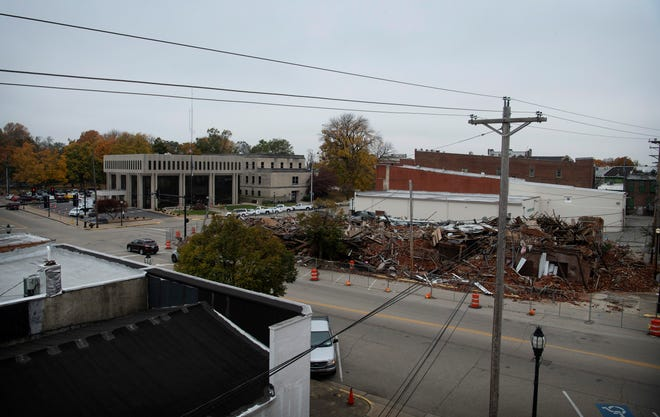 The collapsed rubble of two buildings at the corner of First and Elm streets remains months after the structures were razed in Downtown Henderson.