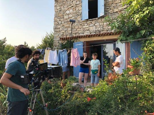 "Cast and crew prepare for a scene in Alex Ko's 2020 short film ""The Yellow Dress."""