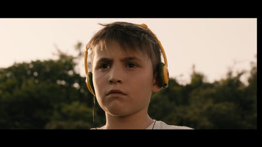 """A still image from Alex Ko's 2020 short film """"The Yellow Dress,"""" in which 10-year-old Raphael (Jules Leyendecker) attempts to express himself through fashion despite his mother's wishes."""