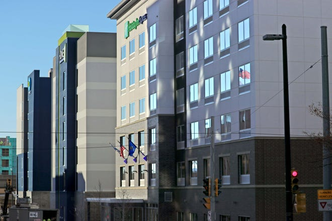 A Holiday Inn Express, a Home2 Suites and Tru hotel are side by side in the 500 block of North Jefferson Street in Milwaukee. Around $70 million in federal grants have been distributed to help Wisconsin hotel operators during the COVID-19 pandemic.