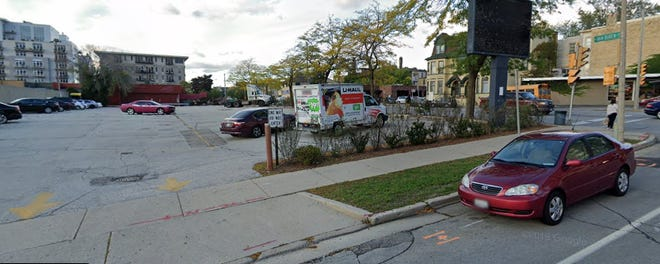 An eight-story, 220-unit apartment building is being proposed for the northwest corner of North Van Buren Street and East Juneau Avenue.
