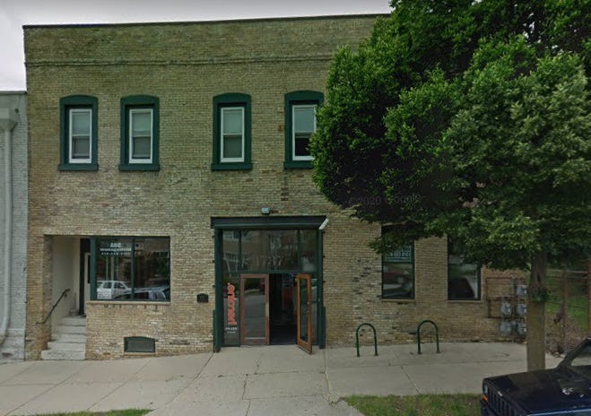 A two-story building at 1737 N. Palmer St. is be razed and replaced by a four-story building with up to 12 apartments.