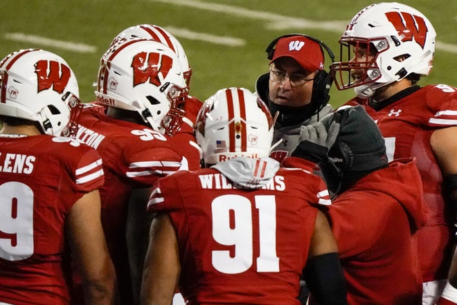 UW head coach Paul Chryst said the Badgers will be without at least 10 players due to COVID-19 when the team plays Michigan on Saturday.
