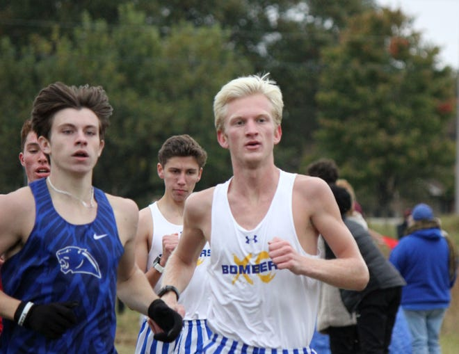 Mountain Home's Whit Lawrence and Andrew Westphal compete at the 5A-West Conference cross country meet on Tuesday at Vilonia.