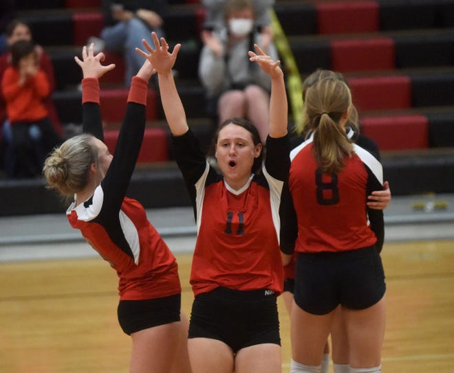 Flippin's Hope Rackley (11) celebrates a point with teammates during the Lady Bobcats' state tournament victory over St. Joseph on Tuesday.