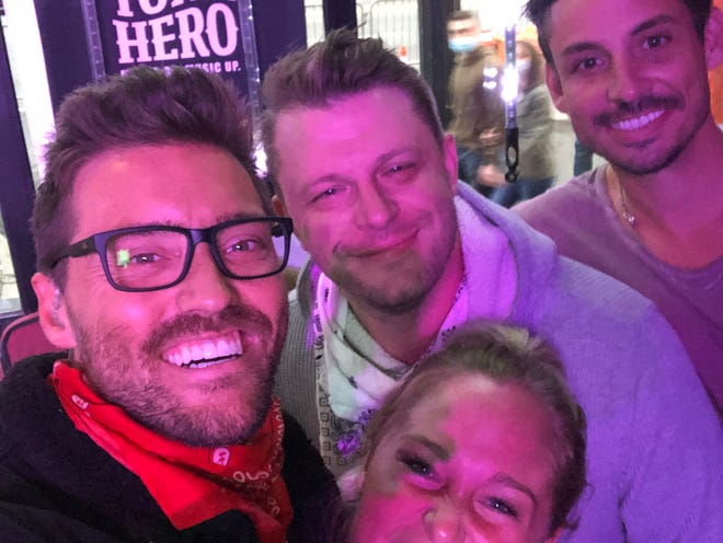 Shawn Scruggs, at center, poses with friends Josh Paige (bottom left), Bridgit James and Ross Webb outside Honky Tonk Central in Nashville on Saturday, Oct. 24, 2020.