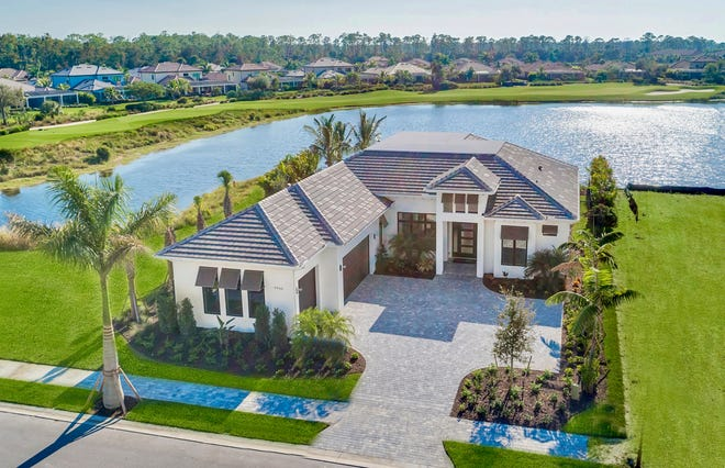Imperial Homes of Naples' Abaco model in Peninsula at Treviso Bay overlooks a lake and the 17th hole of the community's TPC golf course.