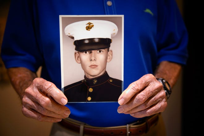 Brent Barents show his US Marine Corps boot camp portrait  Wednesday, Oct. 28, 2020, at his home in Vi at Bentley Village.