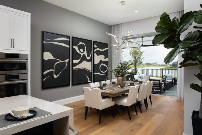 Theory Design's Ruta Menaghlazi, Adriene Ged, and Cynde Thompson created a coastal beach style design with a casually elegant feeling for Seagate's completed Monaco model at Esplanade Lake Club.