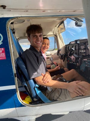 CFTAR Flight instructor Justin Oliver, left, flew with sixth-grader Chris Martinez-Mendez, right, in early October 2020.