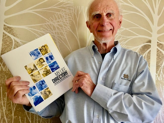 """Neil Hitz holds a copy of """"My Life Directory"""" which he and his wife, Eileen, developed to help people  manage their important information and keep their families running smoothly when they are disrupted by a family emergency."""