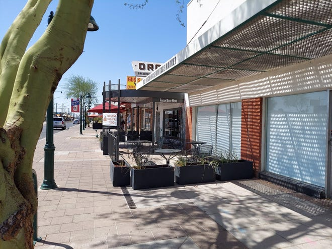 Oro Brewing Co. in downtown Mesa got approval to extend its outdoor seating down the sidewalk, in front of a neighboring business, to help keep customers properly spaced.