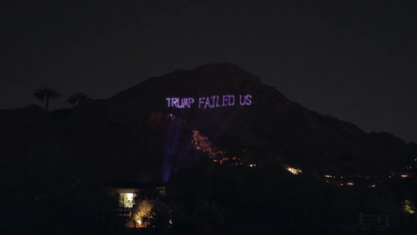 Anti-Trump messages projected on Camelback Mountain