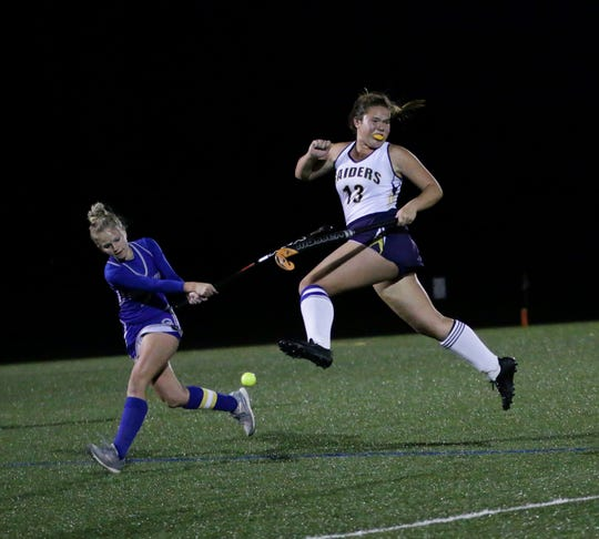 Elco's Anya Kissinger tries to avoid the ball as a Garden Spot player winds up for a shot.