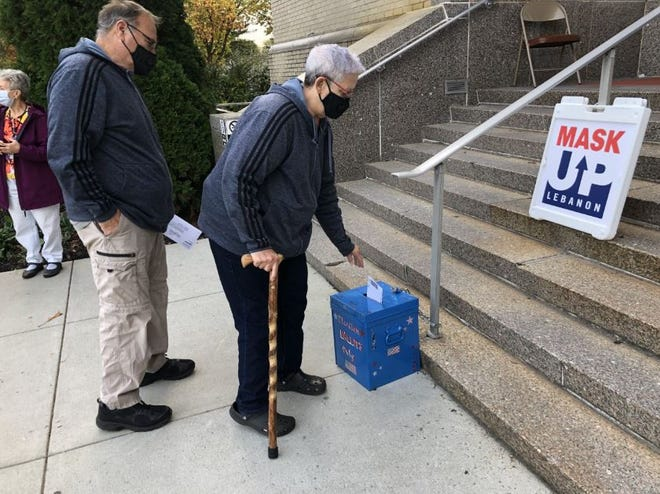 Voters drop off ballots outside the Lebanon County Board of Elections Tuesday ahead of the deadline to apply for a mail-in or absentee ballot or to vote early in-person for the Nov. 3 election.