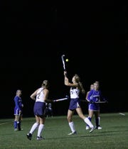Molly Gray (2) and Ashley Yoh (23) look to control a shot in the air during Tuesday night's L-L play-in game vs. Garden Spot.