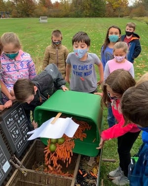 Palms Elementary students compost food scraps. A round of renovation work has allowed the school to rejuvenate its outdoor learning facilities, which include a nature trail, garden and composting area.