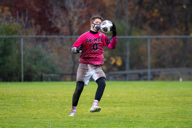 St. Clair goalie Kalvin Heid catches a kick during the D2 regional semifinals against Imlay City Tuesday, Oct. 27, 2020, at Brandon High School in Ortonville.